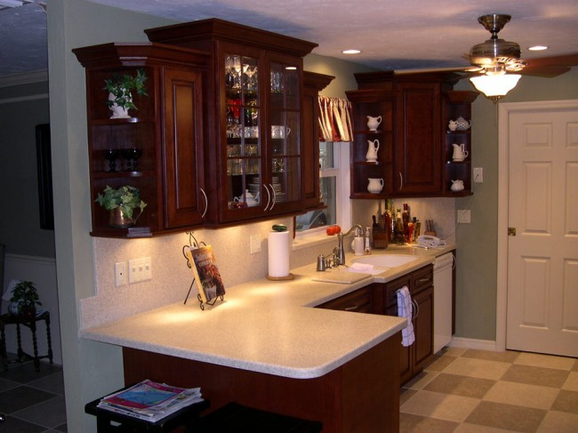 Custom made cherry kitchen with corian sahara tops for Custom made kitchen countertops